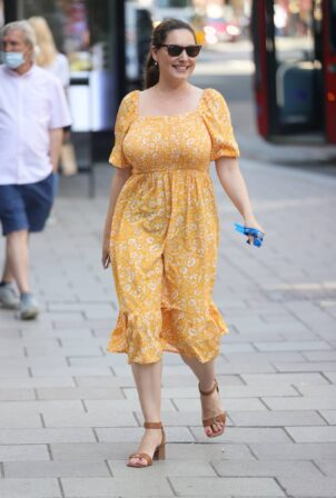 Kelly Brook - Pictured in summery yellow mode dress at Heart radio in London