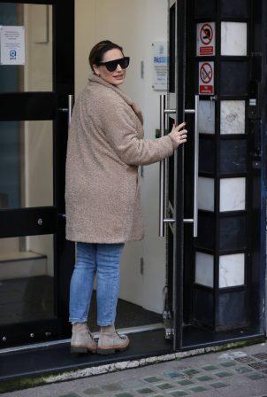 Kelly Brook - Seen in a coat at Heart Radio Studios