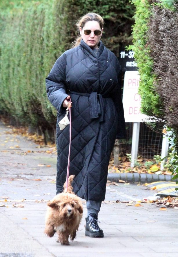 Kelly Brook - Takes her dog Teddy out for a walk in London
