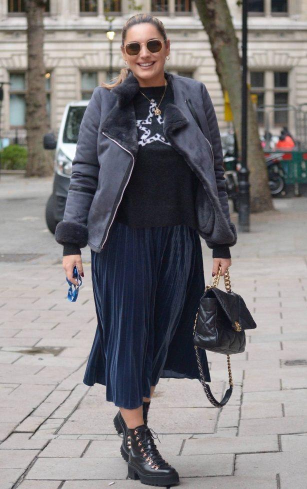 Kelly Brook - Wearing a blue metallic dress, high platform Ed boots in London