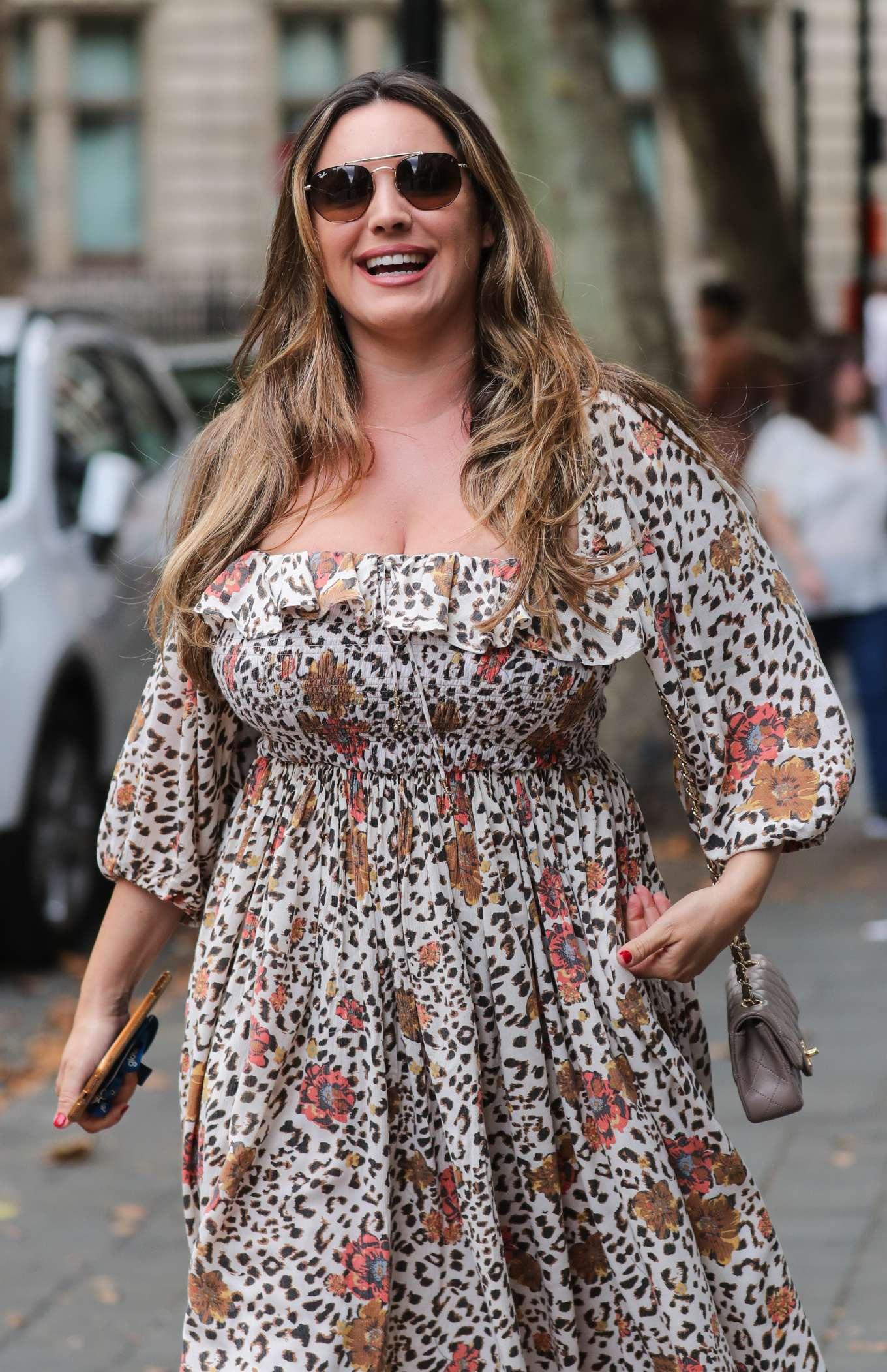 Kelly Brook - Wearing a flower print dress in London