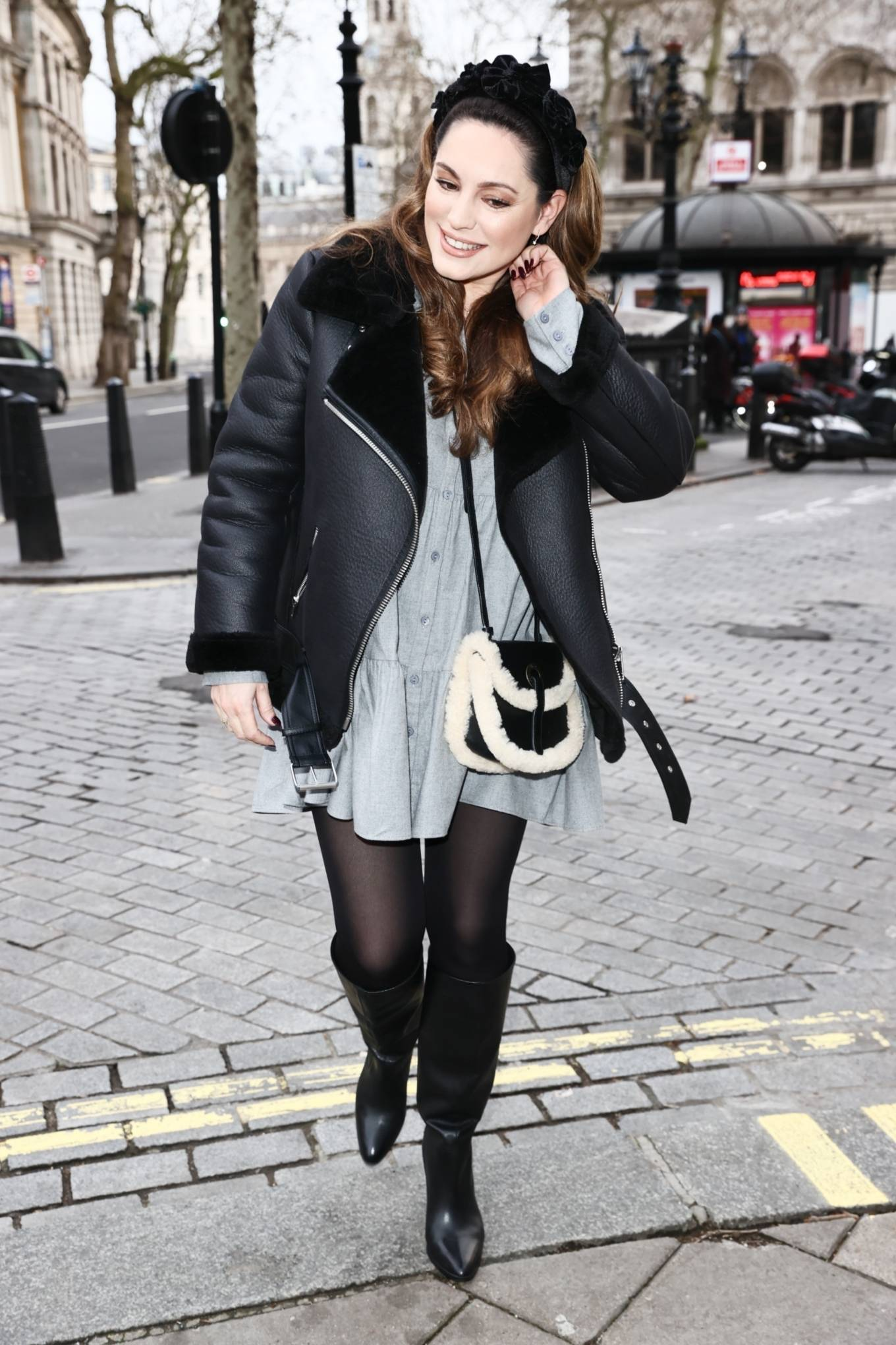 Kelly Brook - Wearing a grey mini dress at Heart radio in London