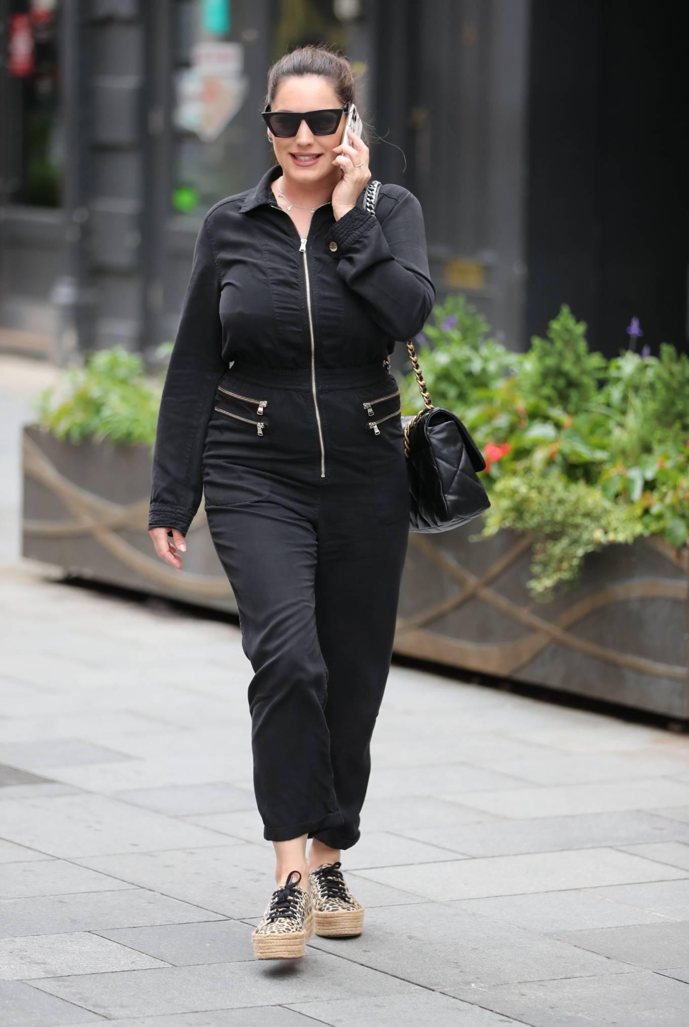Kelly Brook - wearing black boiler suit in London