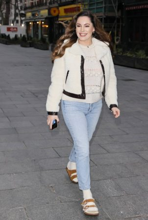 Kelly Brook - Wears sandals and socks to Heart radio show in London