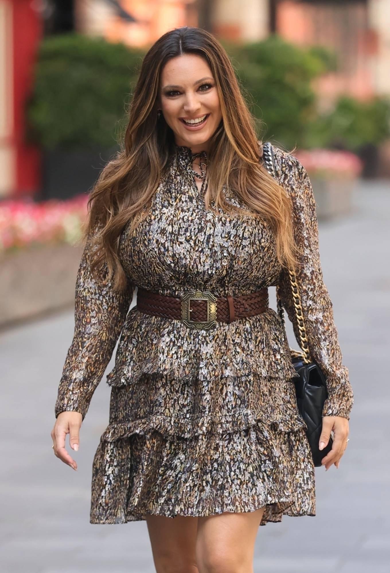 Kelly Brook - Wears sparkling metallic short dress at Heart radio in London