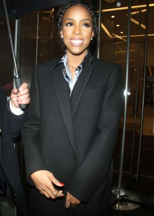 Kelly Rowland in black coat out in NYC