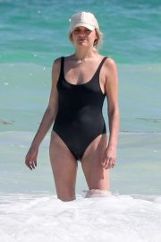 Kelsea Ballerini in Black Swimsuit on vacation in Tulum