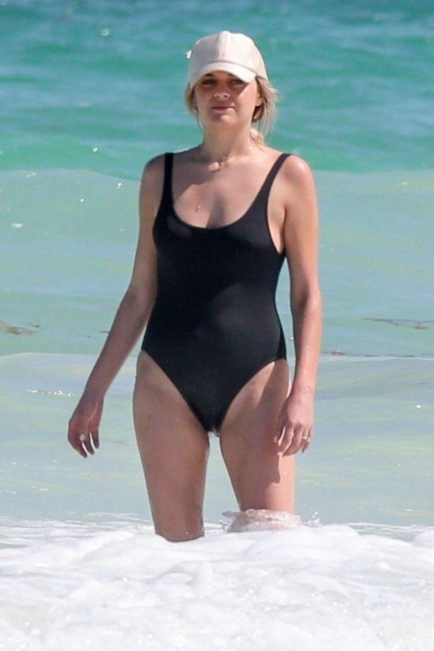 Kelsea Ballerini in Black Swimsuit on vacation in Tulum
