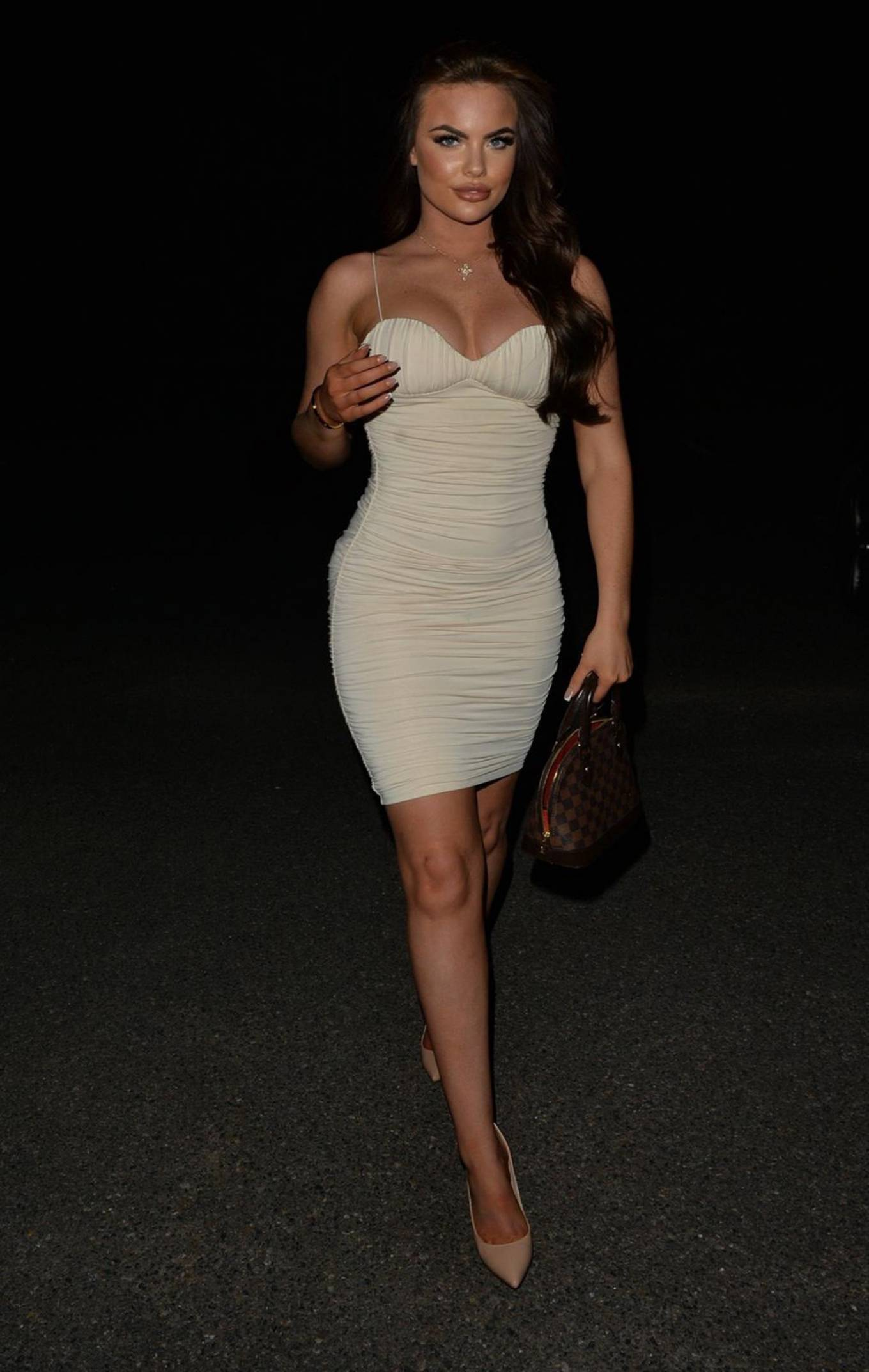 Kelsey Stratford - In tight white mini dress arriving at Radio roof bar in London
