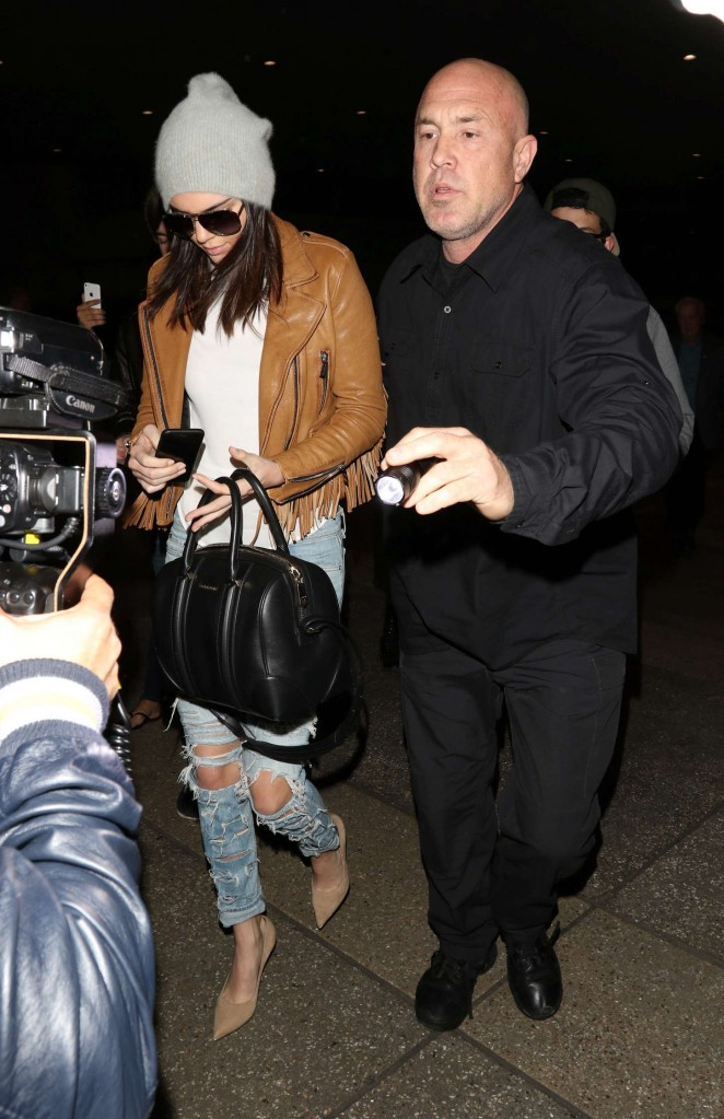 Kendall Jenner in Ripped jeans LAX -04