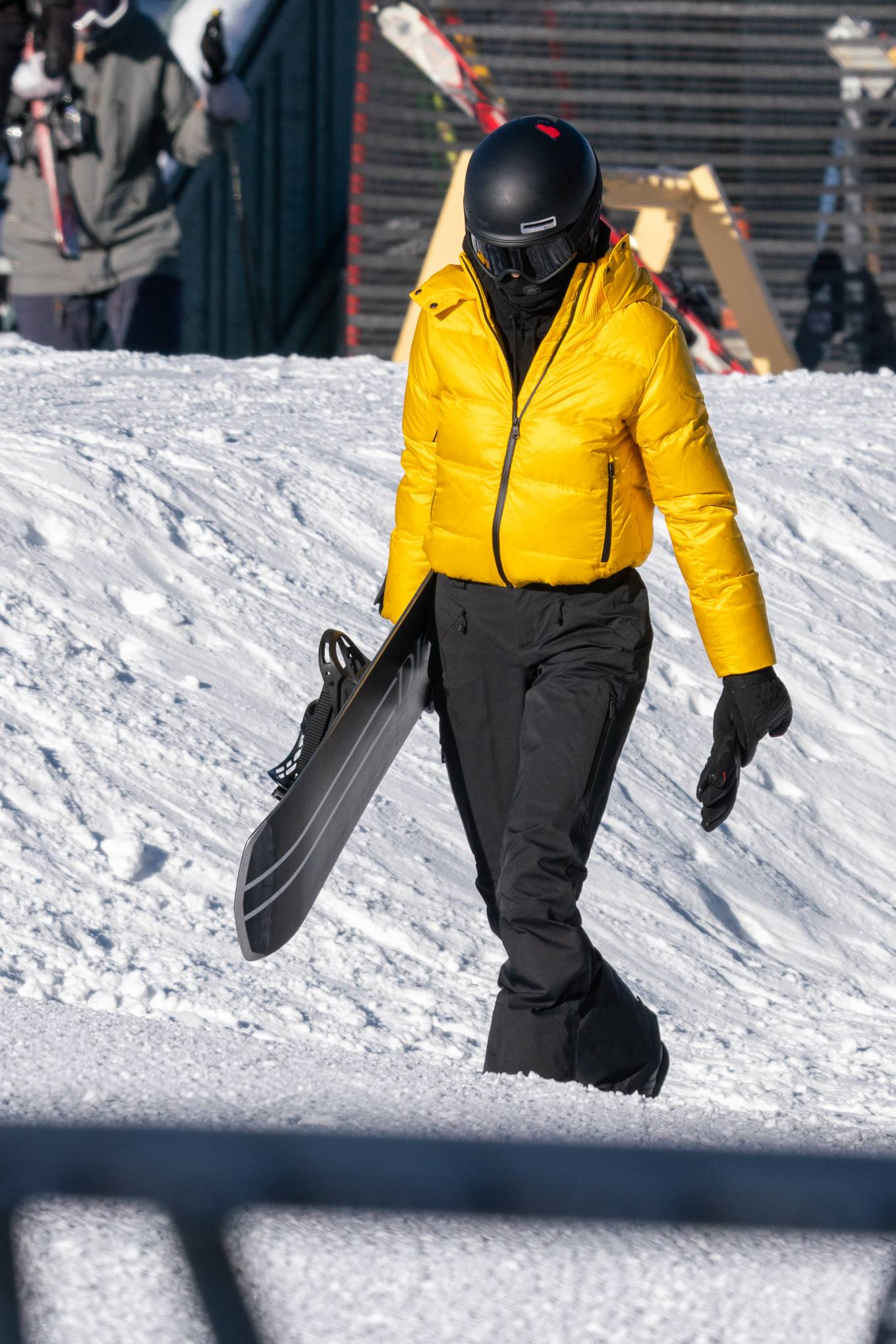 Kendall Jenner - In a ticket-me-yellow Prada jacket and black Prada trousers in Aspen