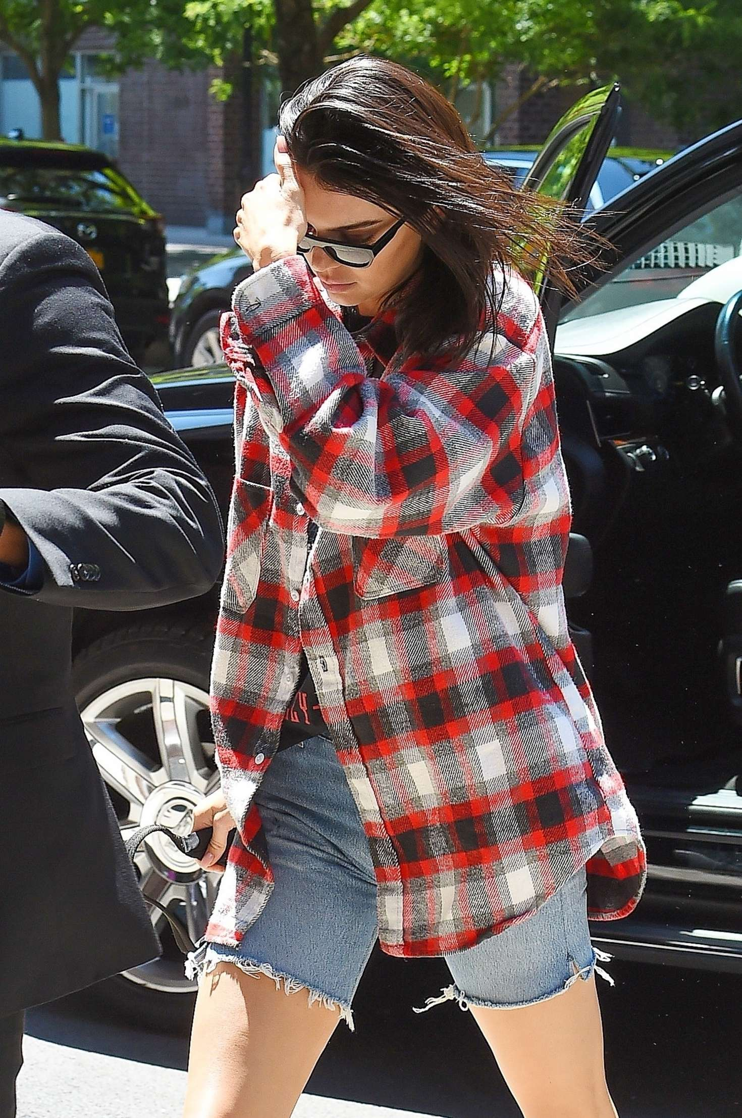 Kendall Jenner – Wearing a Plaid Oversized Shirt and Denim Shorts out in Tribeca