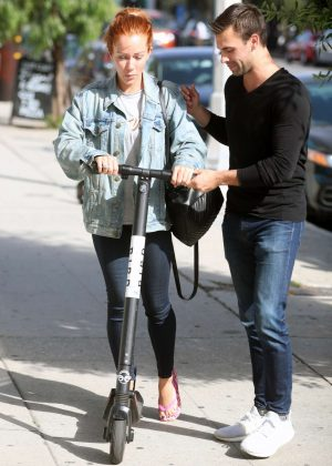 Kendra Wilkinson rides a scooter in West Hollywood