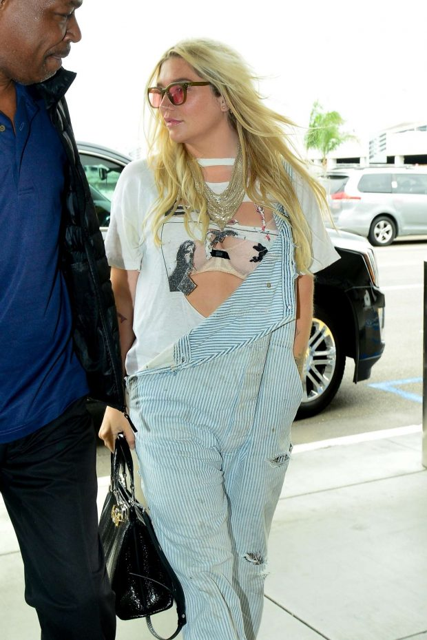 Kesha: Arrives at LAX Airport in Los Angeles -13