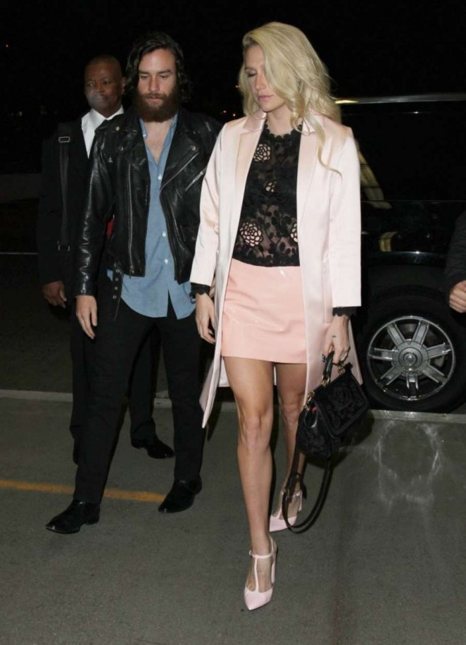 Kesha in Mini Skirt at LAX Airport in LA