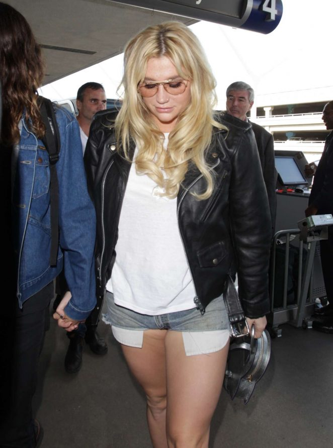 Kesha in Jeans Shorts at LAX Airport in Los Angeles