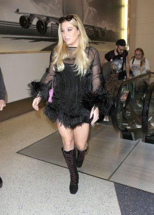 Kesha in Mini Dress at LAX in Los Angeles