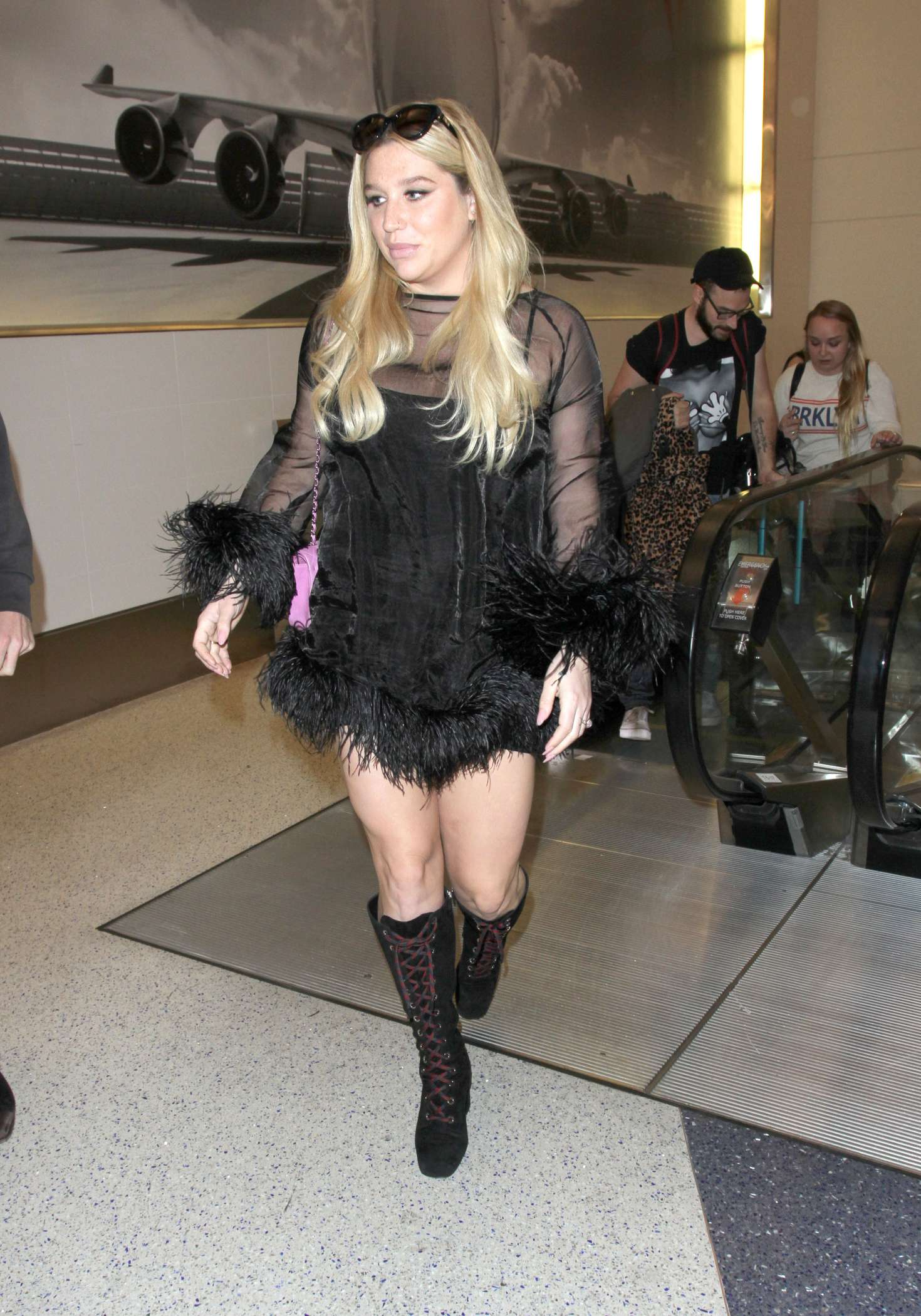 Kesha in Mini Dress at LAX in Los Angeles