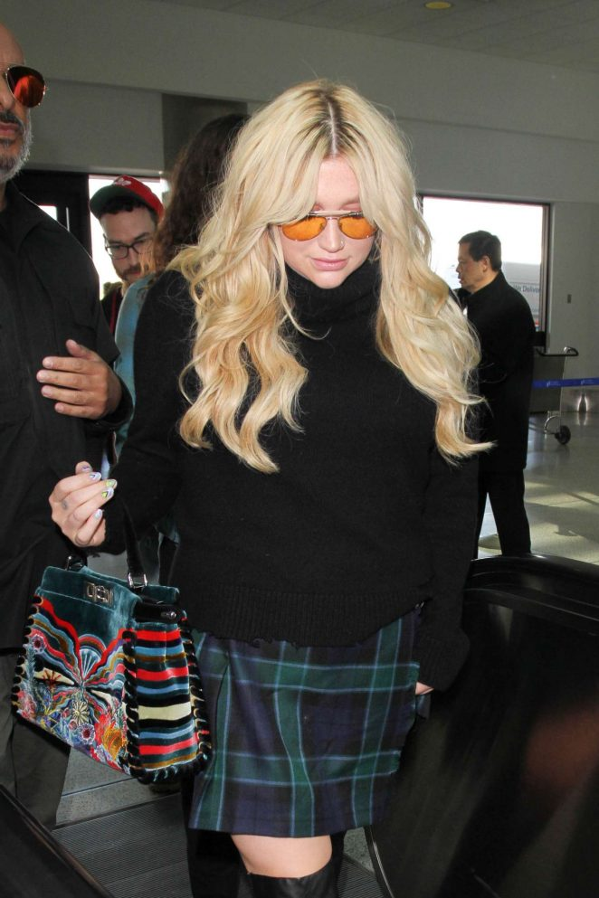 Kesha in Mini Skirt at LAX Airport in Los Angeles