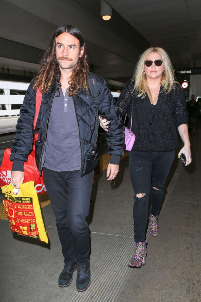 Kesha with boyfriend Brad Ashenfelter at LAX Airport in Los Angeles