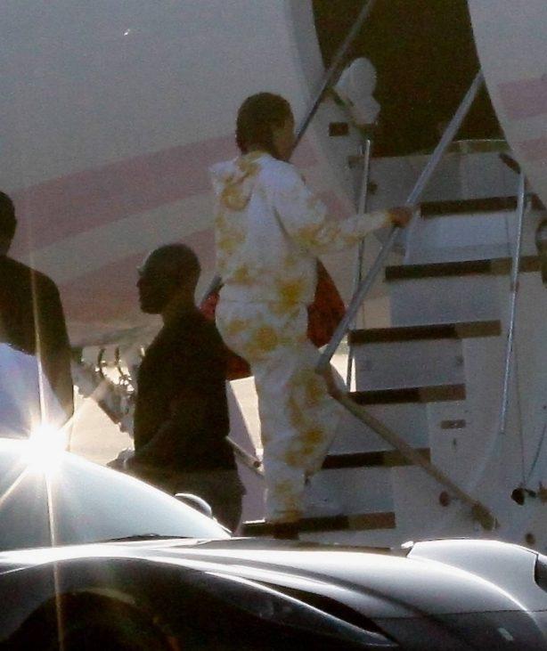 Khloe Kardashian and Kourtney Kardashian - Pictured boarding Kylie Jenner's private jet in Van Nuys