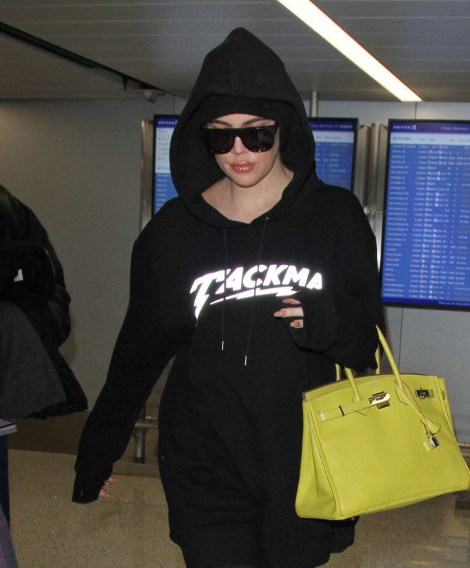 Khloe Kardashian - Arriving on a flight at LAX airport in LA