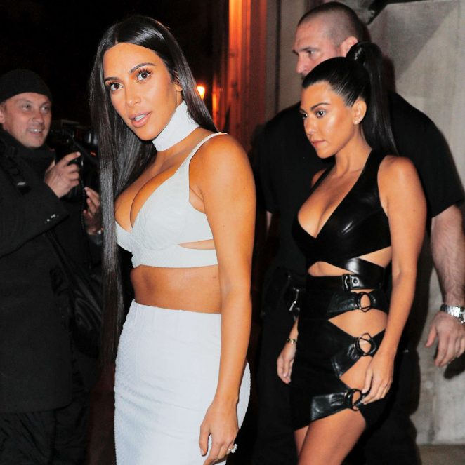 Kim and Kourtney Kardashian in black and white outfits out in Paris