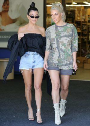 Kim and Kourtney Kardashian Shopping at buybuy BABY in Calabasas