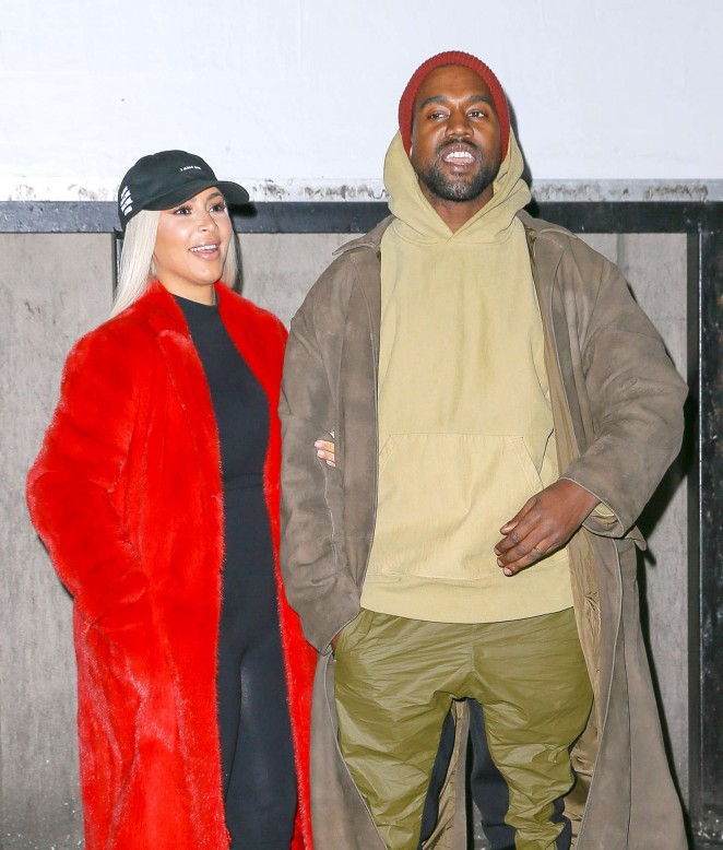 Kim Kardashian and Kanye West Posing in front of YEEZY'S Billboard in NY