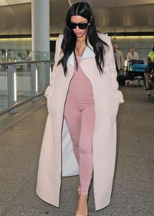 Kim Kardashian in Tight Jumpsuit at Heathrow airport in London
