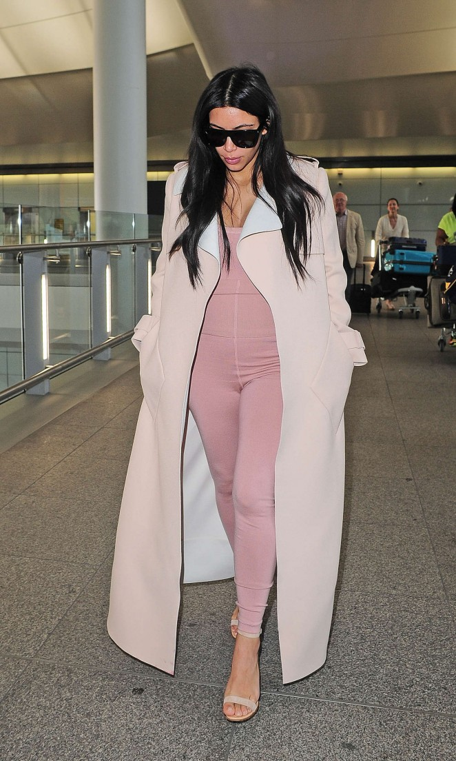Kim Kardashian in Tight Jumpsuit at Heathrow airport in London