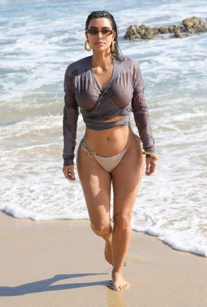 Kim Kardashian - Bikini candids the beach in Malibu