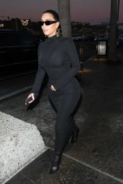 Kim Kardashian - Dressed in a black form-fitting dress at Mastro's Ocean Club in Malibu