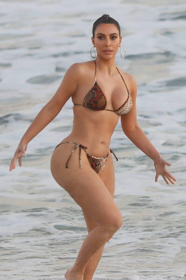 Kim Kardashian - In a bikini on the set KUWTK in Malibu