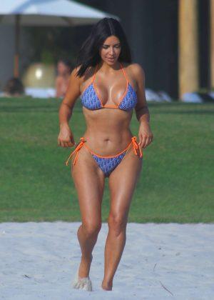 Kim Kardashian in Bikini on the beach in Puna Mita