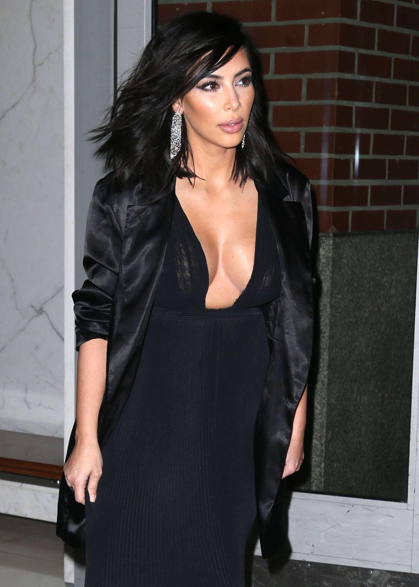 Kim Kardashian In Black Dress Leaving Her Apartment In