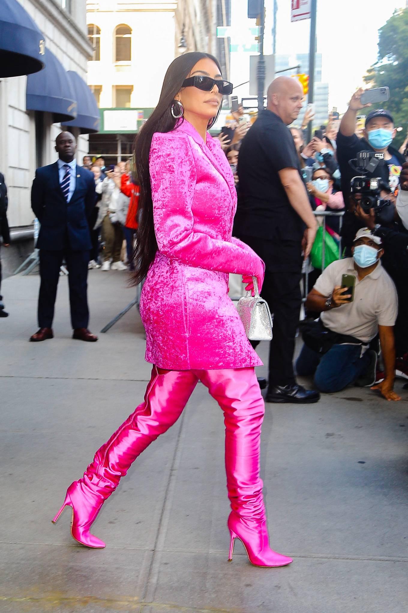 Kim Kardashian – In burning eyes pink Balenciaga outfit exiting the Ritz-Carlton hotel in New York   GotCeleb