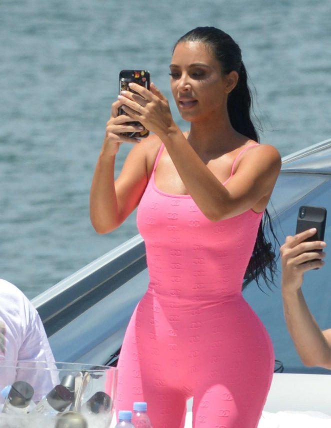 Kim Kardashian in Pink Tights on a boat in Miami
