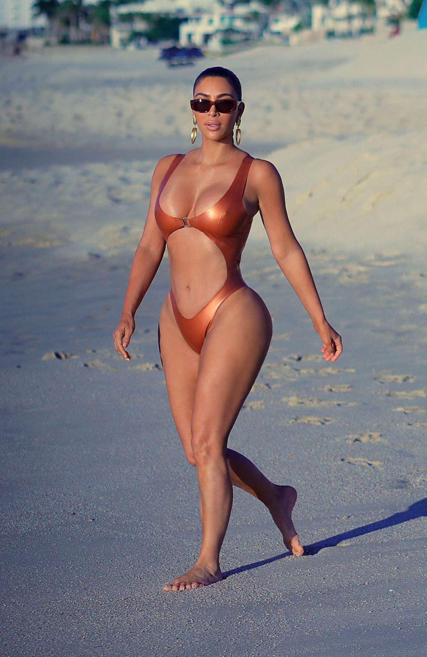 Kim Kardashian in Swimsuit on the beach in Cabo