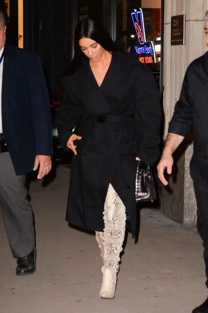 Kim Kardashian in thigh high boots out in New York