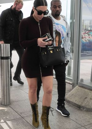 Kim Kardashian in Tight Mini Dress at Heathrow in London