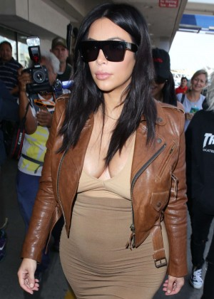 Kim Kardashian in Leather Jacket at LAX airport in LA