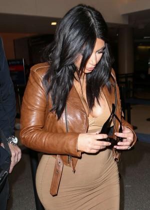 Kim Kardashian in Leather Jacket at LAX -11