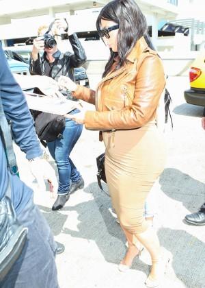 Kim Kardashian in Leather Jacket at LAX -23