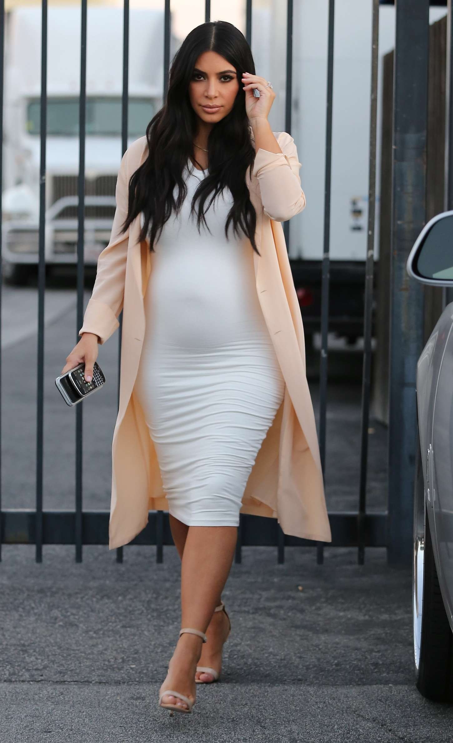 Pregnant Kim Kardashian in Tight Dress -07