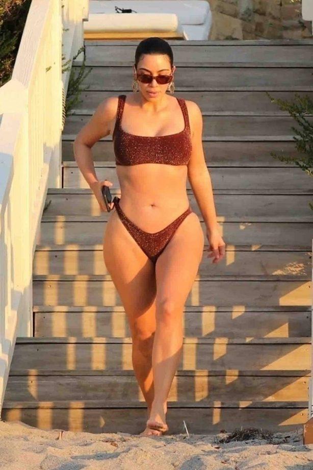 Kim Kardashian - Wearing bikini on the beach in Malibu