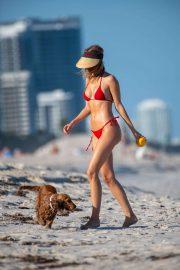 Kimberley Garner in Red Bikini with her dog on the beach in Miami
