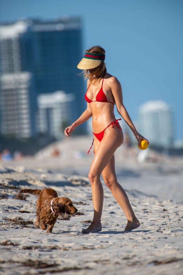 Kimberley Garner in Red Bikini with her dog on the beach in Miami