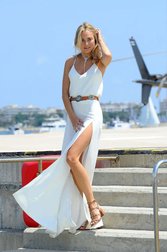 Kimberley Garner in White Dress Arrives in Cannes