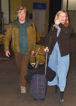 Kirsten Dunst and her fiancee Jesse Plemons at LAX Airport in LA